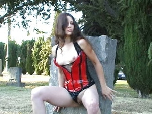 Solo girl masturbating in the cemetery