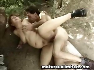 Chunky mature redhead gets pounded by a young dick in the forest
