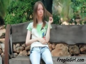 Skinny brunette teen is outside in public and shows her pussy