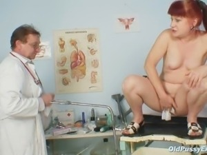 Mature Olga has her redhead hairy pussy gyno speculum exam