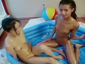 Skinny lesbian hottie getting messy in one pool pussy party