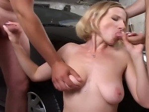 This hot blonde having sex in the car. She pleases two gays letting them fuck...