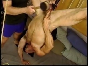 Jim Roberts suspended upside down stuffed with a big dildo and balls BenGayed...