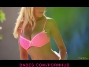 Sexy blonde bombshell strips off her pink panties to masturbate