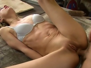 Blonde gets fucked by a carpenter in his workshop. She lets him fuck her cunt...