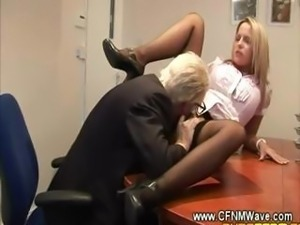Old geezer goes down on young slut on his office table