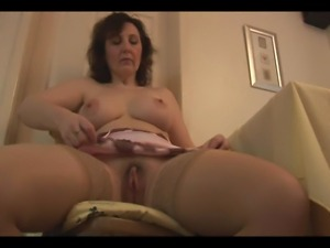 Mature lady in slip and stockings strips to show off her perfect boobs and...