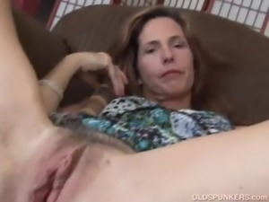 Mature redhead fucks her pussy  ... free