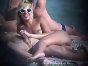 Voyeur blond grabbing his dick on nudist beach