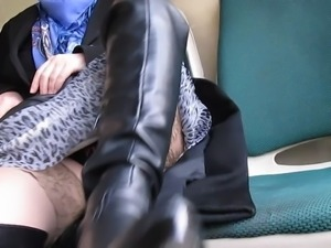 Girl in black leather boots flashing stockings in a bus
