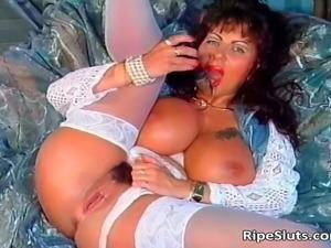 Gorgeous mega boobed mature slut uses her favourite toys