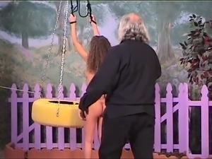 Hot brunette slut with perky tits gets restrained by her older BDSM master