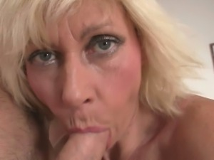 Blonde granny milks young cock