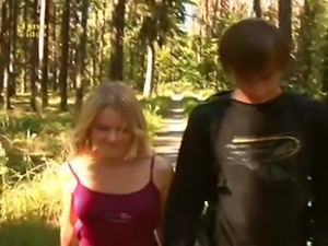 Pretty blonde is fucked in the woods and gets cum on her tum. Odd video, she...