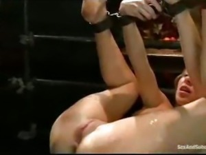 Bound waxed babe gets fisted