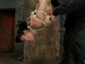 upside down hanging slut getting fucked in the mouth