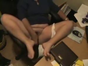 Hidden cam catches my horny mom masturbating at her desk