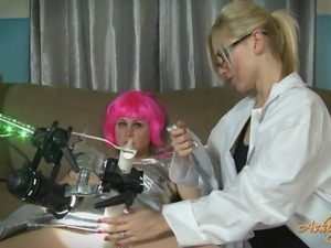 blonde scientist babe checking out her new device