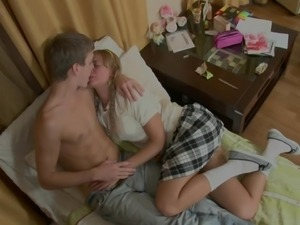 blonde teen's small tits being kissed hard