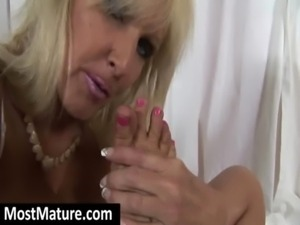 mature licking her own toes and feet free
