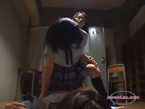 3 Schoolgirls Kissing Fucking With Strapons On The Floor In The Dark Classroo