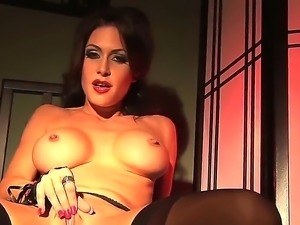 Provocative brunette with big boobs Jessica Jaymes masturbates in sexy black...