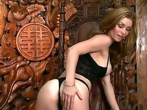 Hot dark haired babe Heather Vandeven is posing on camera, showing her...