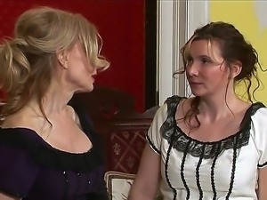 Two pretty MILF houswifes Nica Noelle and Nina Hartley spending time together...
