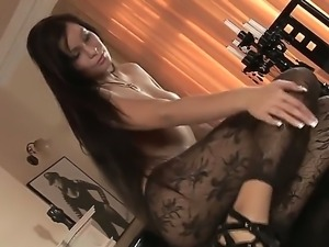 Very hot Asian milf wearing sexy pantyhose posing topless and touching her pussy
