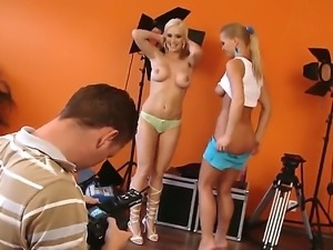 Enjoy two fine sexy blondes Silvia Saint and Stacy Silver posing behind the...