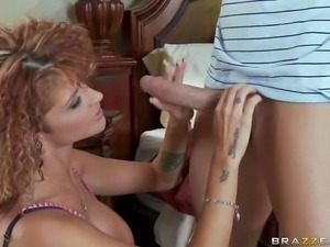 Busty and curly babe Joslyn James enjoys in seducing her