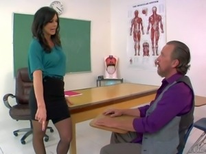 Elegant brunette Kendra Lust in blouse, skirt and nylons is