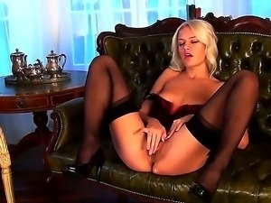 Gentle and naughty blonde babe Evelyn plays with her shaved and sexy pussy