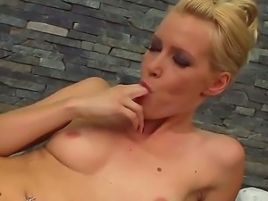 Gorgeous blonde kitten Sophie Moone undusexy and caressing her pussy in the...