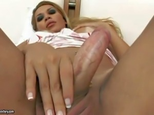 Andreia Mel is s beautiful blond-haired shemale with hard cock.