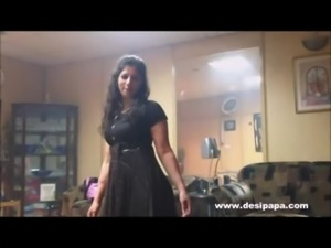 indian wife in bedroom dancing for hubby to tease him to make his mood for...