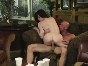 Intense brunette belle fucks on the couch