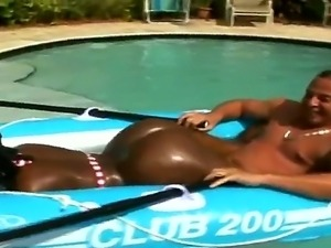 Hot Candy shaking her brown booty on a swimming pool.