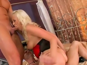 Sexy blonde swallows a huge pole before getting her tight gaping cunt banged...
