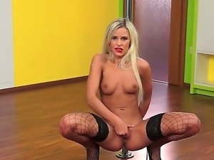 Leggy blonde babe Dido Angel stays in black fishnet stockings and black high...