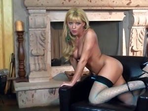 Charing blonde Niki Young in stockings and high heels spreads her legs by the...