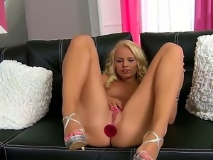 Slutty blonde hottie Vanda enjoys deep fingering her wet twat during naughty...