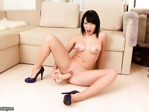 Teen Lina has fun with toy