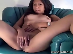 She sits in a chair and slowly takes off all her clothes, exposing the lovely...