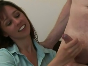 Femdom cfnms jerks dick while sitting on couch