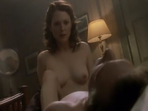 Julianne Moore moaning as she has sex with a guy, laying back on a couch.Then...
