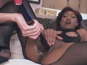 Busty Asian in fishnet clothes stuffing her muffin with all kind of different...