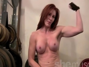 Mature redhead Cat DeSade begins by working out, but just can't keep her...