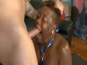 Fat ebony with big belly sucks on a white cock