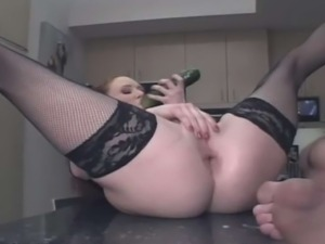 Kinky couple fucks on the kitchen table. They are so horny, using vegetables...